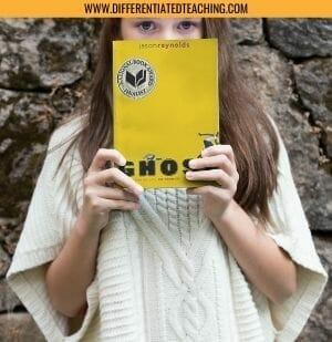 Girl holding Ghost by Jason Reynolds
