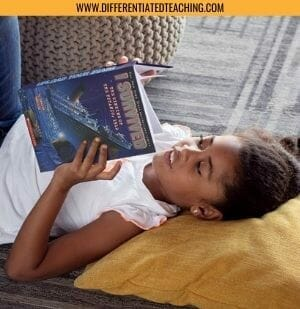 Girl Reading I Survived the Sinking of the Titanic laying on the floor